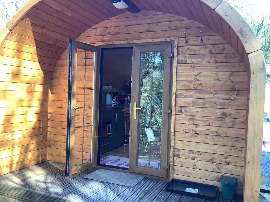 A view of the front doors of the Rivers Edge pod, showing one door open.