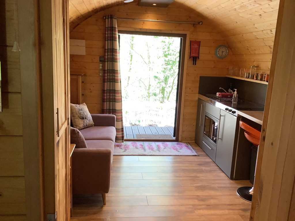 Inside view of the Glamping pod. Wooden Floors and view of river